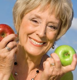 Healthy senior woman with apples for health diet concept